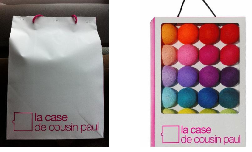 A gauche, le sac que j'ai eu pour seul emballage de la guirlande achetée, à droite le type de coffret que j'avais eu avec le kit qu'on m'a offert.